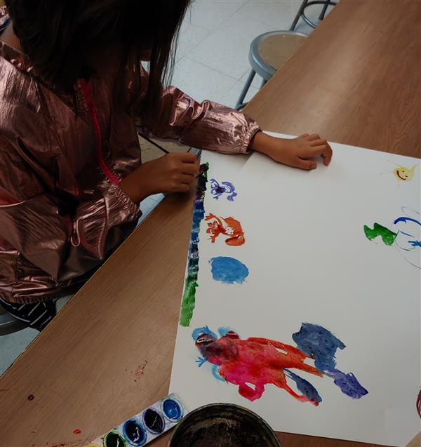 Student working on story painting