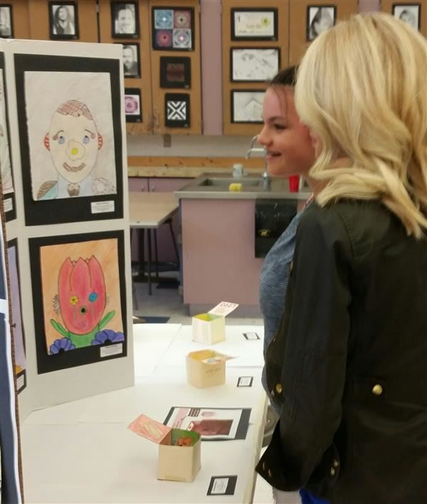 Student Views Their Creative Portrait At M.S. & H.S. Student Art Show May 15 2018