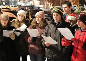 Ballston Spa High School Festival Choir caroling in Wiswall Park before Village Parade 2019