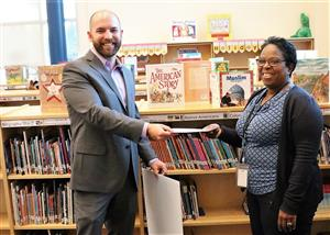 Gordon Creek Principal Keane accepts check from Marvin and Co.