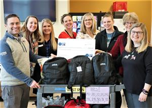 Malta 5K - Applied Materials donation to the Backpack program