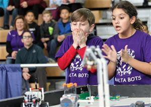 Malta Bots team members react to robot at FLL Competition